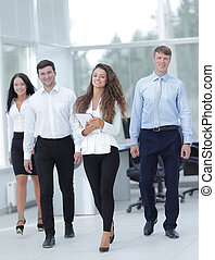 portrait of a group of successful employees - working in a...