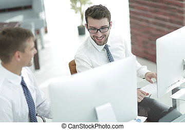 office employees work on the computer