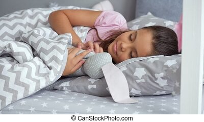 Cute little girl sleeping with her toy - Pleasant moments....