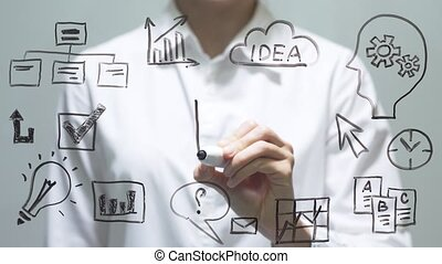 Woman drawing decrease diagram with red down arrow on transparent screen.