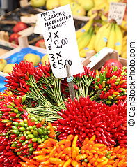 Chilis in the Rialto Market - bundles of hot chillies on...