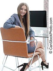 woman administrator sitting at the workplace - successful...