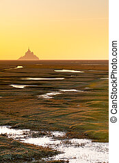 Mont Saint-Michel at sunset from a long distance