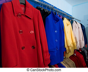 Colorful autumn female wool coats in shop