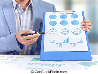 businessman present market share, graph, pie chart