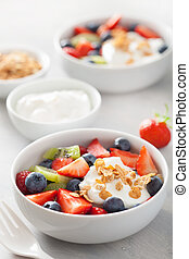 fruit berry salad with yogurt and granola for healthy...