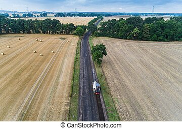Aerial view on working asphalt scrapping machine on country...