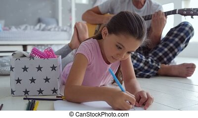 Pleasant creative girl drawing at home - Creative family....