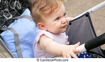 Beautiful baby With blue eyes in the public park and playing...