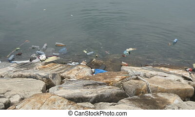 Environmental pollution. Plastic bottles, bags, trash in...