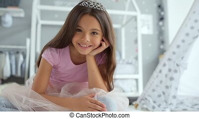 Pleasant smiling little girl resting at home - Happy child....