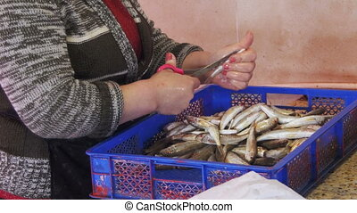 Woman Vendor Cut Up the Fish in the Fish Market Manual...