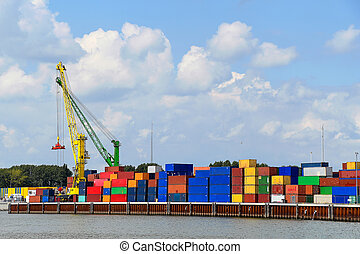 colorful crane with stacked shipping containers