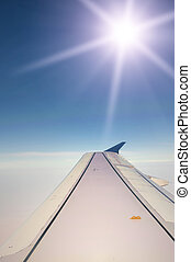 Airplane wing with sun ray