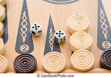 Backgammon - On the game board game backgammon chips and...