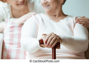 Hands with painted nails - Senior woman holding her hands...