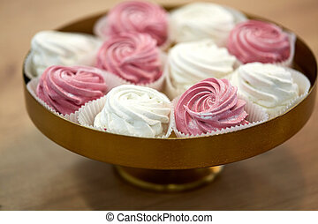 zephyr or marshmallow on cake stand - food, confection and...
