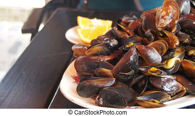 Cooked Mussels on a Wooden Table in the Fish Restaurant -...