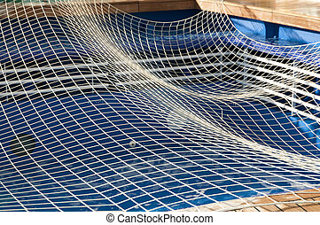 swimming pool - empty swimming pool with safety net