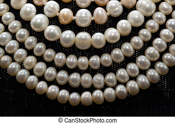 Pearl beads - White and pink pearl beads on black shawls...