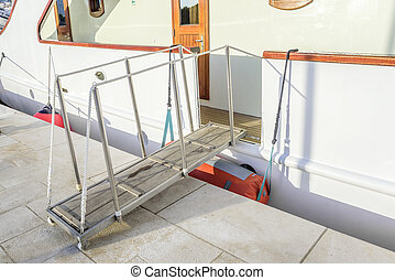 The gangway descended to the wharf. - The gangway descended...