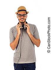 Young man listening to music, on white background
