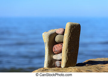 Balancing of stones on the coast