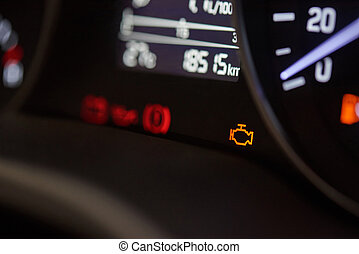 Check ingine icon on modern car dashboard close-up