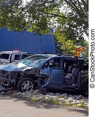 car wreck with child seat - child's car seat in back seat of...
