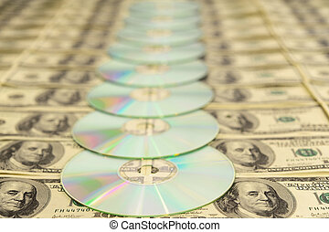 Compact Discs On American Hundred Dollar Bills Background