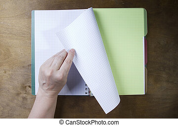Hands turn pages of the notebook - Hands flipping page...