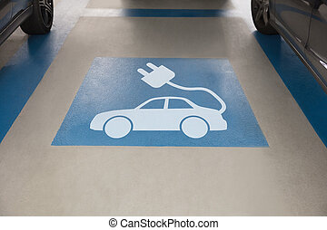 Electric car sign in parking area - High angle view of...