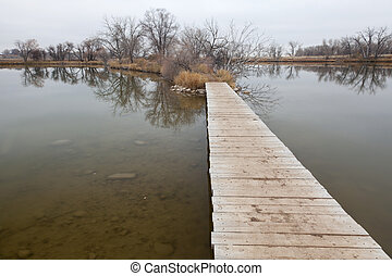boardwalk pathway over lake and swamp - nature trail -...