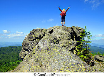 Girl on rock. Tourist on the top of Grosser Arber mountain...