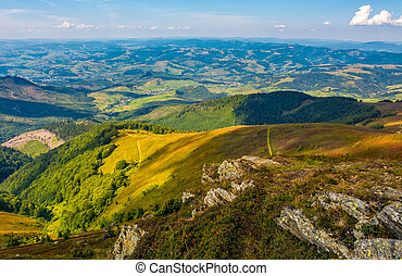 rocks on hillside of high mountain. beautiful valley view in...