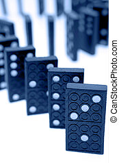Dominoes standing on plain background