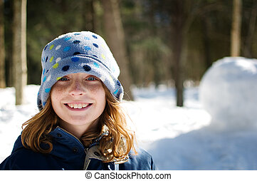 smiling girl in a hat - young happy girl outdoors in winter...