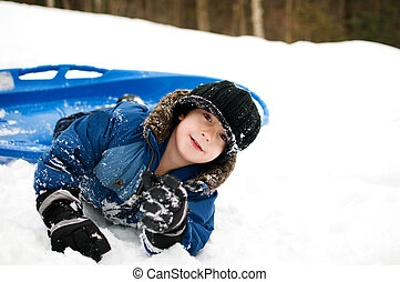 boy outdoors with a toboggan - little boy outdoors in winter...