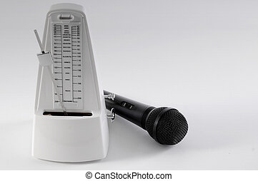 Metronome and microphone on a white background