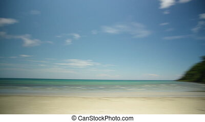 Wide shot of beach - A wide shot of a beach panning shot to...