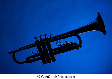 Trumpet Silhouette Isolated on Blue - A silhouette of a...
