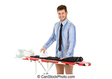 Young caucasian man ironing - Young handsome caucasian man...
