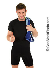 Young sporty man with thumb up - Young caucasian sporty man...