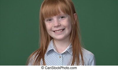 Cute ginger girl with freckles smiling - Close up bright...