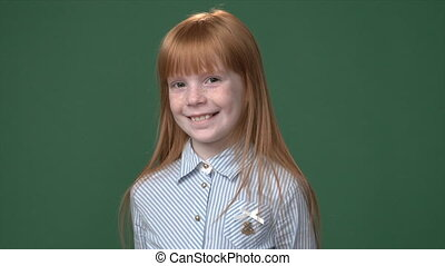 Cute ginger girl with freckles smiling - Cute ginger girl...