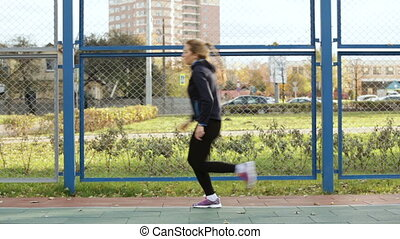 woman athlete doing a shuttle run - Young woman athlete...