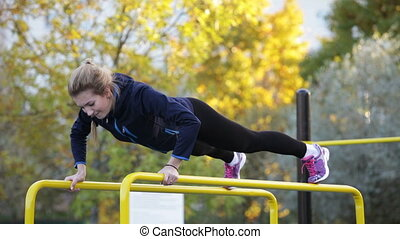 woman athlete doing push-ups - Young woman athlete doing...