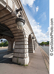Lamppost close-up on Bercy bridge on a sunny day in Paris,...