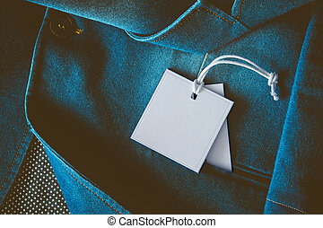 Lable tag - Empty white label on a denim clothing