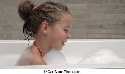 Little girl playing with foam